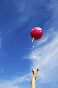 Red balloon blue sky